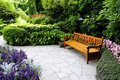 Wooden bench in Butchart Garden Stock Photography