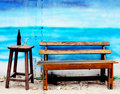 Wooden bench and chair Royalty Free Stock Photo