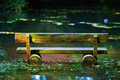 Wooden bench in flood Stock Photography