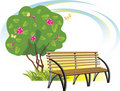 Wooden bench and flowering tree. Spring concept Stock Image