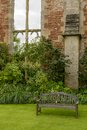 Wooden bench in garden at Bishop palace ,Wells Royalty Free Stock Photo