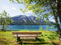 Wooden bench at a lake Stock Photo