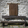 Wooden bench in the mountains Stock Photos