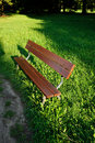 Wooden bench in the park in daytime Stock Image