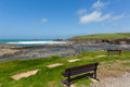 Wooden bench seats overlooking Newtrain Bay North Cornwall near Padstow and Newquay Royalty Free Stock Photo