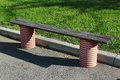 Wooden bench at sidewalk Royalty Free Stock Photo