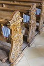 Wooden benches with gotteslob in austrian church german language gotteslobs for the christians temple is a liturgical songbook Stock Photos