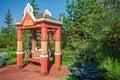 Wooden big swing in garden Royalty Free Stock Photo