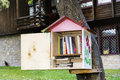 wooden Bird house  with books -reading outdoor Royalty Free Stock Photo