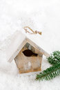 Wooden bird house christmas decoration on snow background white Stock Photos