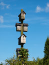 Wooden bird house with clear blue sky background vertical image Royalty Free Stock Images