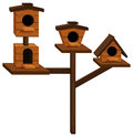 Wooden bird houses on one pole