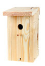 Wooden birdhouse isolated over white Royalty Free Stock Photography