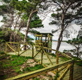 Wooden birdwatching cabin by the water path to a Stock Images