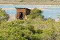 Wooden birdwatching hideout amidst a natural park in santa pola Stock Images
