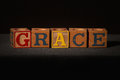 Wooden blocks spelling out the word grace