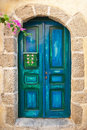 Wooden blue old door of greek island Stock Photos