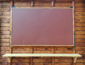 Wooden board for advertising with a shelf Royalty Free Stock Photo