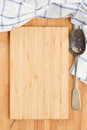 Wooden board blue napkin and spoon empty on a table Royalty Free Stock Image