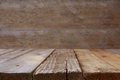 wooden board table in front of wooden background Royalty Free Stock Photo