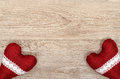 Wooden board with two read hearts and bordures Royalty Free Stock Image