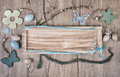 Wooden board on wood background with spring decodations Stock Photos