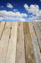 Wooden boards with blue sky over a clouds Royalty Free Stock Photography