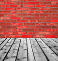 Wooden boards and red brick wall background of Stock Photography