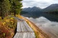 Wooden boardwalk along the lake in the mountains rakhmanovskoe east kazakhstan altai Stock Photos