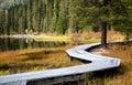 Wooden boardwalk along the lake in the mountains rakhmanovskoe east kazakhstan altai Royalty Free Stock Photos