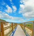 Wooden boardwalk in capo testa under a cloudy sky sardinia Stock Photography
