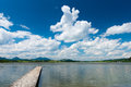 Wooden boardwalk at lake hopfen am see with blue sky and clouds Stock Images
