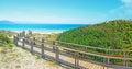 Wooden boardwalk by the shore in capo testa sardinia Stock Photo