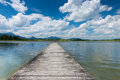 Wooden boardwalk at swim lake hopfen with blue sky in spring Royalty Free Stock Photography