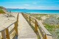 Wooden boardwalk to the beach in capo testa sardinia Royalty Free Stock Photos