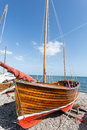 Wooden boat a on a beach Stock Photos