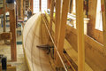 A wooden boat being built new fresh wood sailing vessel in the process of having it s shell Royalty Free Stock Photography