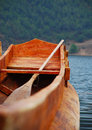 Wooden boat floating in lugu lake yunnan Stock Photography