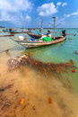 The wooden boat with the motor in sea water Royalty Free Stock Photo