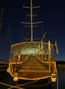 Wooden boat at night view of the traditional croatian and moving the entrance to the ship docked in the port of makarska vertical Royalty Free Stock Images