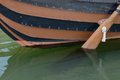 Wooden boat with a paddle closeup Royalty Free Stock Photo