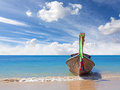 Wooden boat on pristine beach, nature background