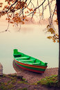 Wooden boat on the river bank Royalty Free Stock Photo