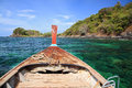 Wooden boat sailing on crystal sea to beautiful island near Koh Lipe Royalty Free Stock Photo