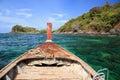 Wooden boat sailing on crystal sea to beautiful island near Koh Lipe Royalty Free Stock Photo
