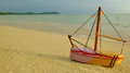 Wooden boat toy on the beach natural Stock Images