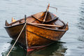 Wooden boat on water Royalty Free Stock Photo