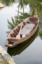 Wooden boat on water old Stock Photography