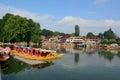 Wooden boats on Dal lake in Srinagar, India Royalty Free Stock Photo
