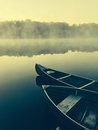 Wooden boats in misty river Royalty Free Stock Photos